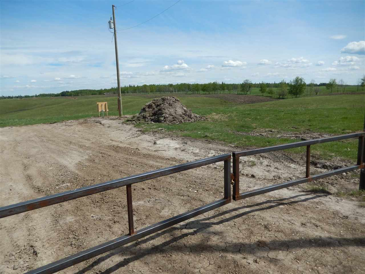 ROLLING 3.86 ACRES close to Lake Isle & Wabamun Lake....POWER is COMPLETE and the DRIVEWAY is in....just needs some more gravel.   Property is TOTALLY FENCED with a GATE.  Gas to property line.  Plenty of opportunity here for a WALK-OUT.  Only 1.5 miles of gravel after pavement.