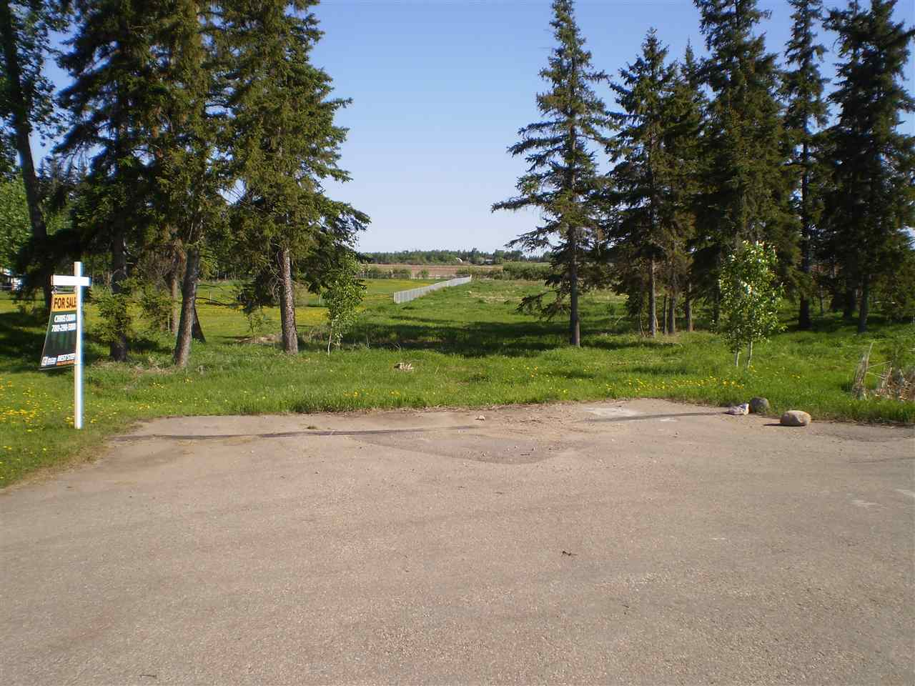 Beautiful 2.5 acres treed lot to build on. Paved to Subdivision and close to Beaumont, Nisku, Leduc and International Airport. Easy access to Highway 21. Have builder who will quote you a new construction price if needed.