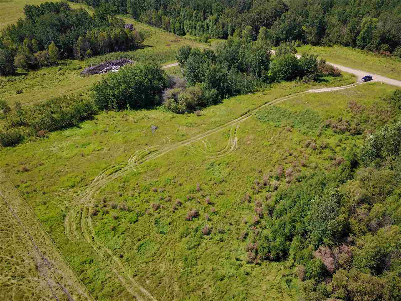 Perfect for weekend getaways or to build your dream home! This 4.99 acres of gently sloping land is out of sub-division and fenced on 3 sides. The trees on the north and south sides of the property provide privacy and a beautiful setting nestled in nature.