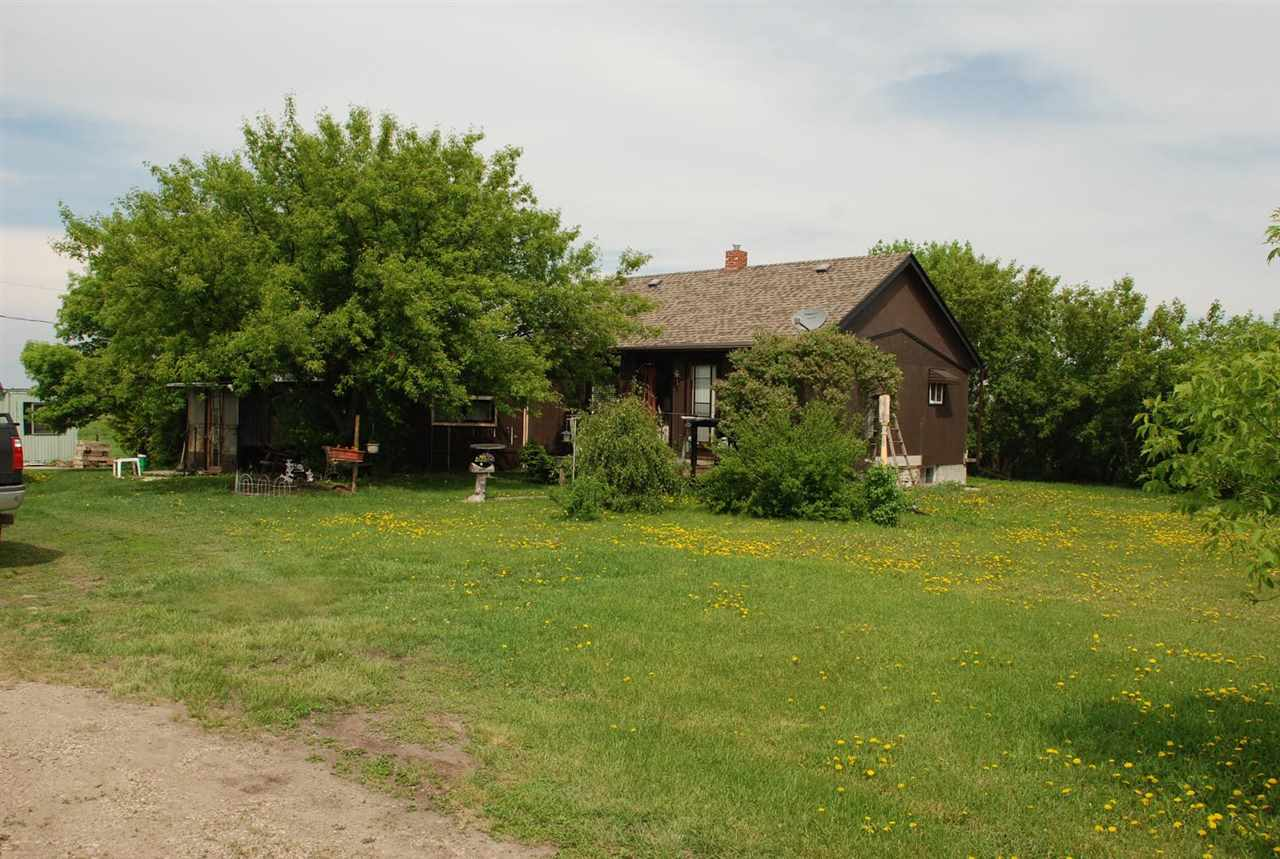 Great retreat with lots of room for extra vehicles & storage. 4.82 Acres with older updated home and lots of out buildings. Enjoy the peace and serenity with fruit trees, a vegetable garden, and dugout.