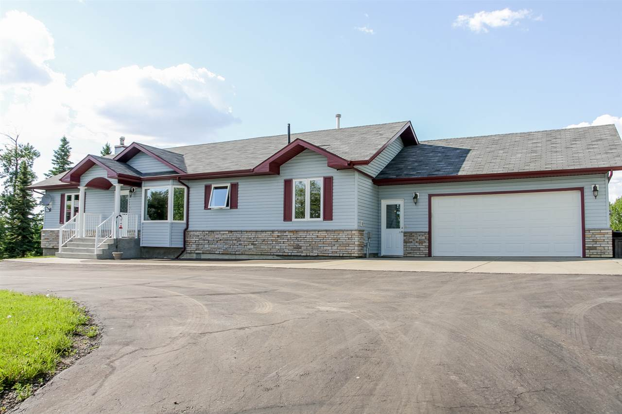 Bring your heart for outdoor living to this amazing acreage just 15 min (on pvmt) from Leduc in Cloverlawn Estates. A gorgeous view, 1631 sq ft, 3 bed, 3 bath bungalow & 19+ acres of green space to call your own!! The home boasts vaulted ceilings, large open concept main living area, & tons of natural light from a plethora of windows! The master bedroom is spacious & the 5 pc ensuite is a dream!  There are two more bedrooms & a 4 pc bath with laundry on the main floor. In the basement you will find a beautifully finished basement with wood stove & plenty of room for entertaining, along with a 4th bedroom & 3 pc bath. The large property has many family fun features, including a trout pond & a golf hole, with plenty of space for biking, walking, quadding, snowshoeing, snowmobiling, etc! Outbuildings galore with a db attch garage, 24x30 db detch shop (with generator hook up) & 12x24 single detch garage, not to mention the storage sheds & greenhouse! Beautifully landscaped, with a new vinyl white ranch fence!