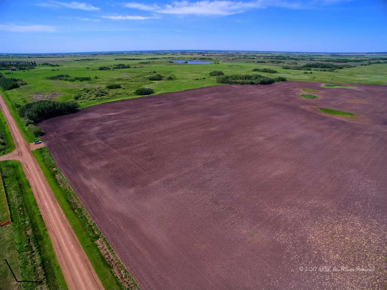 This 80 acre parcel of land  just minutes east of Chipman is partially fenced and a portion of the land is in crop and a portion in pasture.