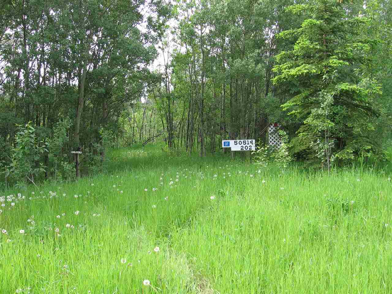 Approximately 4.35 acres of natural scenery.  Well treed with good building site and some water.  Also included are couple of sheds and storage facility approx. 16'x24'.