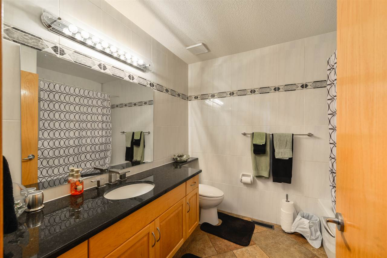 1946 yellow and grey tile bathroom - Beautiful 1946 Sq Ft Bungalow On A Gorgeous Lot And Only Steps Away From The Sturgeon Golf Course This 5 Bedroom 3 Bath Home Offers Tons Of Parking With A