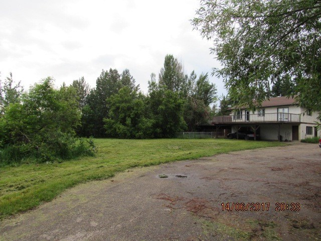 This 28 acres is located only 10 mins from Edmonton and Spruce Grove!  It is a very unique property; in the past it was a licensed successful Dog Kennel set up.  The second level of the bungalow offers 3 bedrooms, den area, huge family room that opens to a deck that over looks your 28 acres that is partially treed. The lower level was set up as a office, check up room, training area and then access to the indoor kennels.  Out the back door you have access to the other section of kennels.   Although the living area will need some work, this is a great opportunity if you want a large parcel of land close to town or maybe you want to inquiry to the County about starting an amazing business.  Large paved parking area shaded by large maple trees.  Don't miss out...WELCOME HOME!!