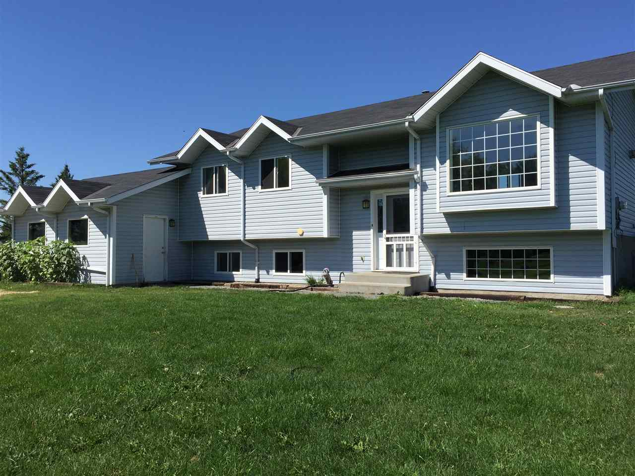 Great family home, great location!  Five minutes from Sherwood Park and five minutes from Ardrossan just off Wye Road in Adam Lily Acres.  1077 sq foot bilevel on 3.2 acres fenced and cross fenced for horses with shelter.  With a total of 4 bedrooms plus a den and 3 bathrooms, this provides great space for a family.  On the main floor you have newer hardwood floors with nice size kitchen, living room and eating area.  Patio doors lead you out to the large deck.  Also upstairs is the master bedroom with 4 piece ensuite including a jetted tub!  Another full bath and 2 more bedrooms complete the upper floor.  The basement is completely finished with laminate flooring and large windows, a large rec room, one bedroom, a bathroom, an office and laundry.  Such a great floor plan and good use of space.  And the shingles are only a year old.  Move in ready!