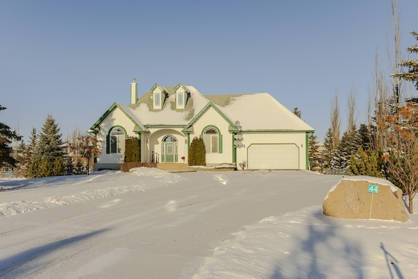 Stunning 30-foot cathedral ceilings and numerous windows provide loads of natural light in every room of this 4-bedroom walk-out bungalow. This elegant country estate is surrounded by gorgeous landscaping and located just steps from Edmonton and Big Lake. A large open kitchen with granite counters overlooks the central great room with gas fireplace.  Entertain guests in your formal dining room or outside on a spectacular 650 sq. ft. deck with panoramic views of a park like backyard.  The master bedroom offers a fantastic ensuite bathroom with jetted tub, separate shower and large walk in closet. The fully finished walkout level with tiled in-floor heating boasts a large family room, a 4th bedroom with walk in closet, a separate bathroom with steam shower and ample storage rooms, and a massive covered patio.  This air-conditioned home also offers an oversized heated double attached garage and an oversized heated double detached garage (28x26) ideal for a workshop. Enormous driveway in a beautiful setting.
