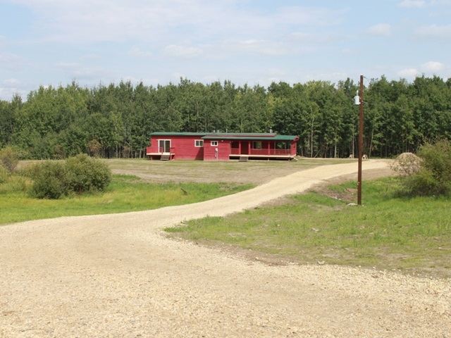 Super clean -- ready to move in!   Paved all the way to this 3.88 Acre parcel located in Beaver County, 30 minutes east of Edmonton and Sherwood Park and the Edmonton International Airport (YEG).  Just 15 minutes to Tofield.   2 bedroom Bungalow with new hot water tank, new cistern, new septic service, R40 insulation under floor and R20 in the walls.  Total living space of 1112 SQFT.  Open kitchen-living room with vaulted ceiling, and wood burning stove. Maple hardwood flooring and open timber framing throughout.  Skylights in bathroom and laundry offers lots of natural light.  Decks on east and south sides and deck off master bedroom. Huge dugout.   Great community to live in -- Spilstead Hall is nearby and hosts many community events including Streak Fry's twice a year.  Welcome home!