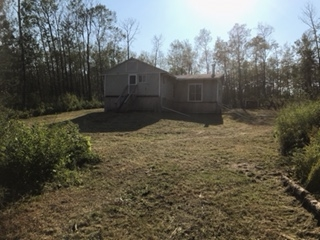 Two bedroom home on a new basement. This 864 sq. ft. home on Lower Mann Lake is perfect for someone looking for a great deal and who doesn't mind doing a little work. This 1980 home has been moved onto a new basement and the installation needs to be completed. The lot is over 1/2 an acre and is set into large trees on three sides giving you a very private setting for spending your summer at the lake. The 1200 gallon cistern is installed in the basement and all it needs is a pump and pressure tank to connect it to the already plumbed home. The power and  gas are at the property line and the home is wired and has a gas furnace. Have a look and make an offer.
