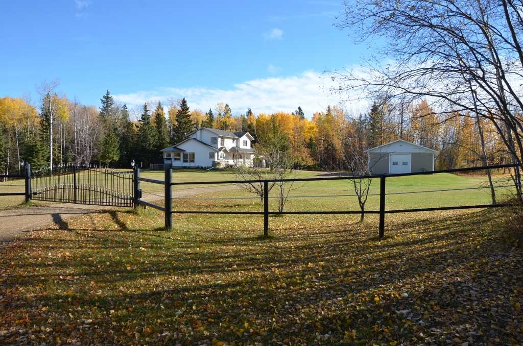 Fabulous property w/ a peaceful atmosphere & lifestyle that can't be beat. Large manicured & picturesque 9 acre yard w/very mature spruce filled bush surrounding home along the N & E sides located 1/4 mile off Hwy 33, 16 miles NW of Barrhead. Wonderful modern home & buildings. 1750 sq ft 2 story 3+1 bedroom, 3.5 bath home. Tasteful finishings & design start at the entrance & continue on thru out the kitchen, dining & living combination w/bonus open glass office/sunroom. High vault ceiling design w/balcony overlooking living area from upper bedrooms. Gas fireplace for winter & A/C for summer. Freshly built wraparound back deck w/black aluminum railing facing mature sheltering trees, firepit area & BBQ space. Brand new 35 yr shingle roof. Fully finished basement features convenient storage & a good rec room which provides a great play area for young & old. Double attached heated & insulated garage. Additional detached high wall heated & insulated shop w/large enclosed cold storage area for RV's, recreation.