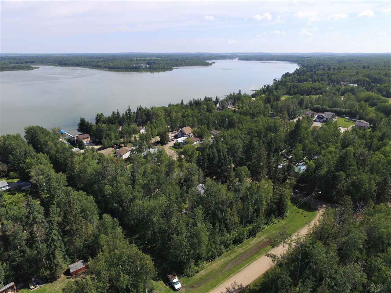 Fully Treed Lot at Lake Nakamun. Steps to the Lake. Corner Lot means Only One Neighbor and Loads of Parking. Power and Gas at the Property Line. .25 Acres (10,890 sq.ft.) of Solid Trees. Plan your lot the way You like it. Great Opportunity. Boat launch is close and a Big Park is a couple blocks away. Lake Nakamun is a one of Alberta's Hidden Treasures when it comes to Lakes. Not too busy. Quiet and Easy Going Lake Life. Take a Look, Walk Around and see why Poeple LOVE Living at Lake Nakamun. Water Sports in the Summer and Sledding/Ice Fishing in Winter. Full 4 Season Fun!!