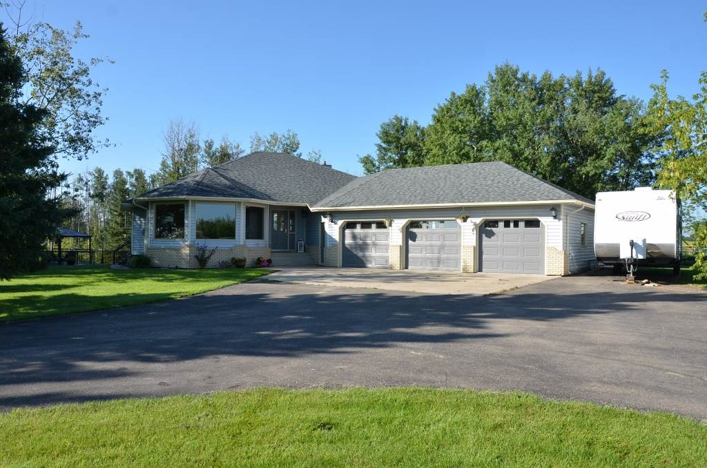 AMAZING Property & Location only 2 miles from town limits & less than a minute from Barrheads Premier 18 hole golf & country club. Modern & attractive 2035 sq ft bungalow built into the hillside w/ stylishly updated fully finished walk out basement. Triple bay attached & heated oversize garage. Great open concept main living areas w/ space that can't be beat. Quality materials top to bottom including extensive new high end cork floors & more. Convenient main floor laundry & grade level entrance on both floors will make this home a reality from the raising of your family right into your twilight years ahead. Imagine the evenings & weekends watching the kids play or enjoying a peaceful country night from your expansive two tier BBQ & entertainment decks overlooking the privately sheltered back yard & fire pit areas. Unheard of 3.5 acres of chain link fenced pasture for any assortment of family animals. Too much to list & So Much to See in this fully finished package that your dreams will be made of