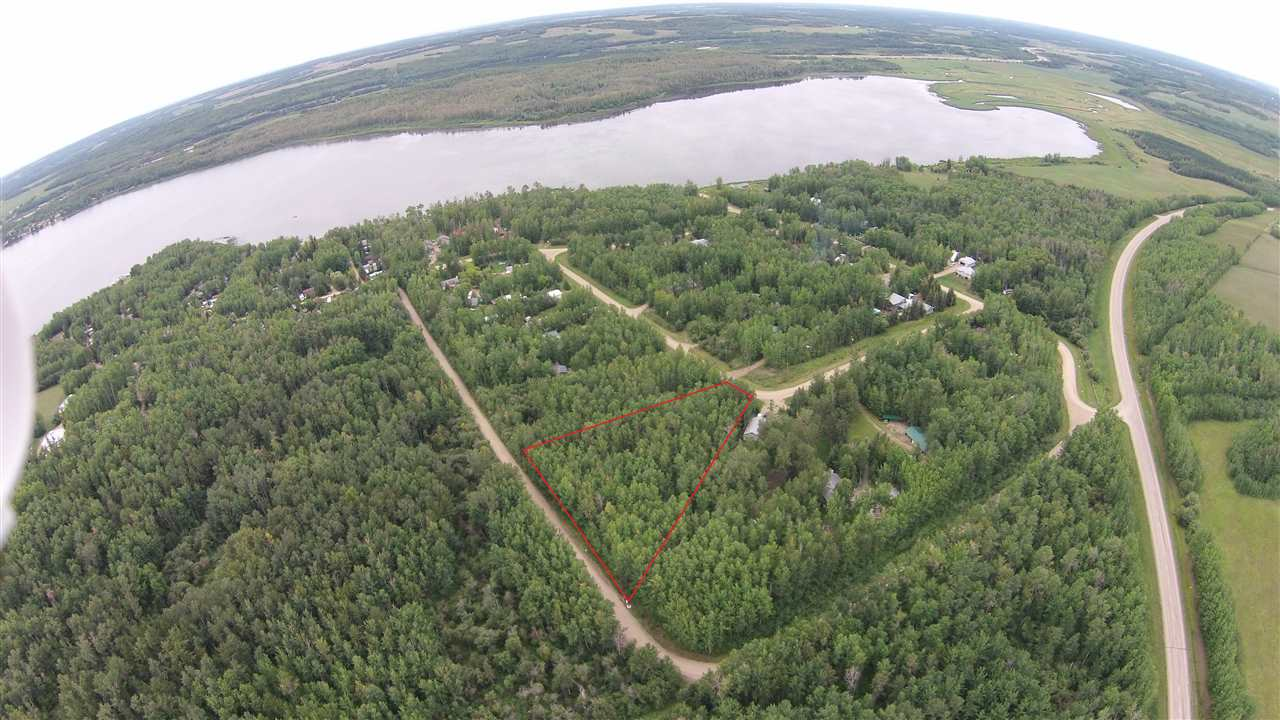 Welcome to 14 Woodland Bay Estates! This 1.09 acre pie shaped lot is beautifully treed and private, and just steps to the lake! The subdivision is great for building your dream home or a weekend cottage with utilities to the lot line. A boat launch and dock are around the corner from you, bring out all your water toys! Only 5 minutes north of trans Canada highway 16, this lot is easy to find and no driving on confusing back roads to get here. Start making your memories this summer!