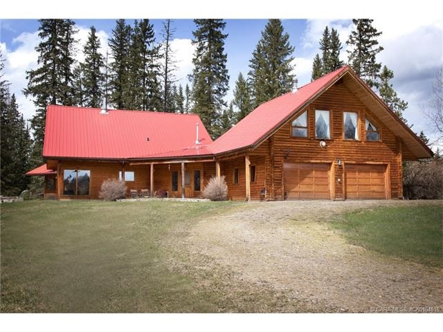 """Recreational hideaway, executive retreat, working ranch... you decide how to best use this picturesque 160 acres. Home is built with energy efficiency in mind with structural insulated panel walls and roof, finished in pine log siding, as well as solar panels and a natural gas powered generator to provide reliable """"off the grid"""" independence. Attached double garage with an immaculate one bedroom guest suite above. Landscaped yard, rock gardens and year round spring fed stream flowing behind the house can be enjoyed from the decks or the screened in summer kitchen. Previously an efficient cattle operation the quarter is perimeter and cross fenced for rotational grazing with cattle handling facilities lending itself well to any livestock operation. Or focus on recreation as the property is surrounded by crown land providing you a private oasis in the wilderness. As an added bonus there are road use agreements generating approximately $21,100/yr."""