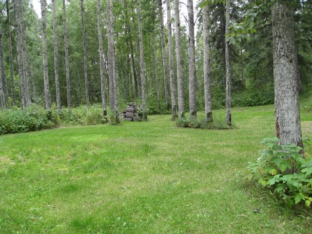 Get ready to enjoy this 1.0 acres with power. Has lots of different places to park your RV along with 5 risers. Has a large tree house too. Nicely treed lot and is nice & private along with being in a quiet cul de sac at Lessard Lake Estates.