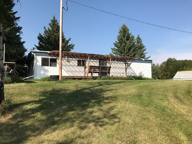 Welcome to this private, scenic, 3 acres in located in Strathcona County beside 2 acres of reserve land. This piece of land has a terrific mix of open and treed space allowing pasture for some animals as well as privacy for yourself.This 1142 sqft double wide mobile home has been extensively renovated over the last number of years with newer kitchen cabinetry, windows, drywall and HWT. there was also a new furnace put in in 2010. The kitchen and eating area are spacious and open to the large living room with wood stove. There are 3 bedrooms with the master having a 2 piece ensuite. Completing the main level is a 4 piece main bathroom and a back entrance. Complimenting the property is a double detached heated garage, a covered back deck and a new fire pit area. The property is cross fenced with 4 pastures and is within a 15 to 20 min drive to Fort Saskatchewan or Sherwood park. This is a terrific first time acreage for a first time buyer .