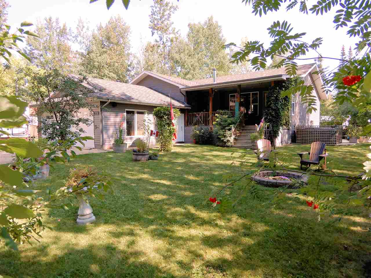 Why just buy a house when you can buy a lifestyle! Fantastic raised bungalow on extra large lot in the Village of Ross Haven. House features 4 bedrooms, 3 baths, and a partially finished basement. This house is loaded with upgrades; open concept with a large kitchen meant for entertaining, main floor laundry, hand-scraped solid maple flooring, large covered veranda, River Rock wood burning fireplace, built-in vacuum, in-slab heat in oversized double garage, a 6 person hot tub, custom wood shed, fire pit, cherry and apple trees, and so much more. 1 minute from your sandy beach, dock with a spot for your boat. Streets are assigned a private beach and lake access, The Summer Village of Ross Haven is a friendly, tight knit community where everyone knows everyone. Located a short 30 minutes west of Spruce Grove and an easy commute to Edmonton.  Lac Ste Anne is a large lake known for its summer and winter recreation and fishing. Come discover what your new lifestyle could be!!
