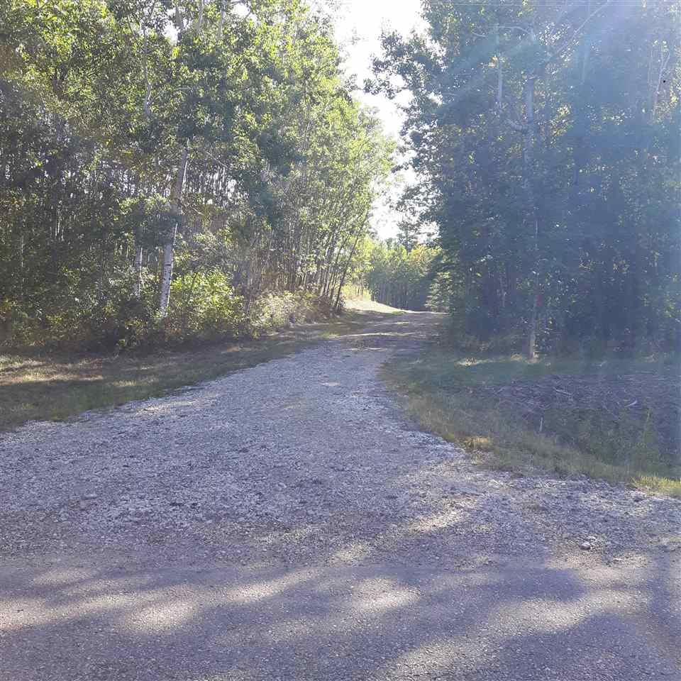 Here's your opportunity to build your dream home in a very private rural setting located only 10 minutes east of Sherwood Park. This 35.5 acre parcel is just under 590 feet wide and 2622 feet in depth. The private tree lined driveway has been excavated with new gravel that leads you to a cleared area, perfect for your new home. All services are at the property line.  An added bonus is municipal water on Range Road 214 and can be brought in for connection. Only 10 minutes from Sherwood Park and paved road all the way to your driveway. GST may be applicable.