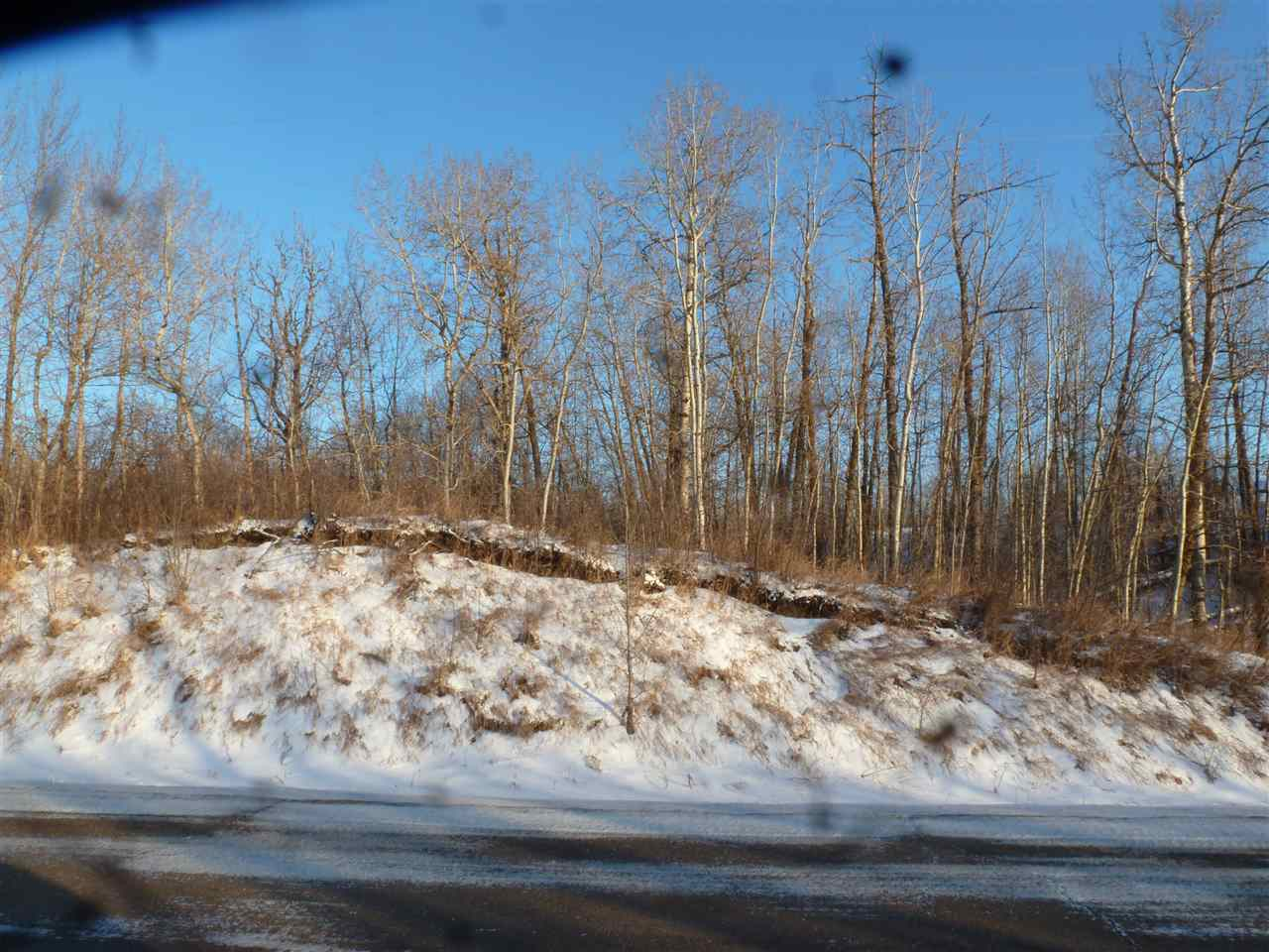 4.99 Acres - Raw Land/Vacant Lot on the North side of the Hamlet of North Cooking Lake. All trees - zoned Country Residential. Let your Dreams Run Wild! All kinds od potential!