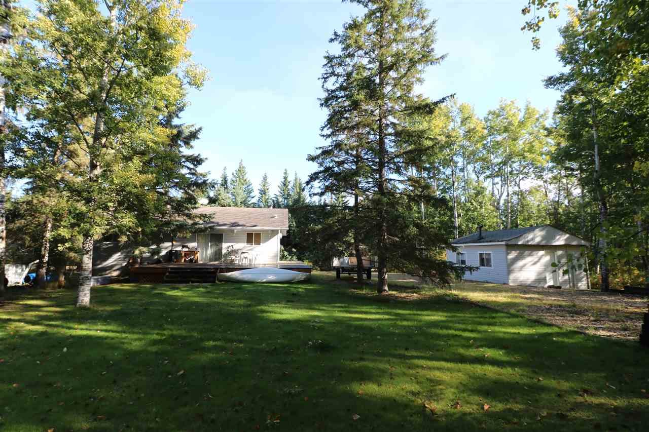 BEST KEPT SECRET!! Nakamun Park is where you will terrific FULL time lake home. Newer 1000 sqft 3 bedroom bungalow on a full BASEMENT!! This gem features large windows, great open concept kitchen/dining/living area, freestanding wood stove, 3 spacious bedrooms, a large 4 piece bathroom, on demand hot water, and a half wrap around deck!! The island kitchen offers loads of counter and cupboard space with garden doors leading to the outside retreat. The basement awaits your finishes with rough in for an additional bathroom. Double lot gives all the room and privacy one could want with plenty of trees and sides a reserve with Lake access just out front. There is an older cottage on the property which could be fixed up to its previous glory as well as additional storage sheds. Lots of parking and plenty of room to build a big garage. Nakamun lake is a great for fishing, boating, and swimming and locals know it is on of the cleanest lakes around.