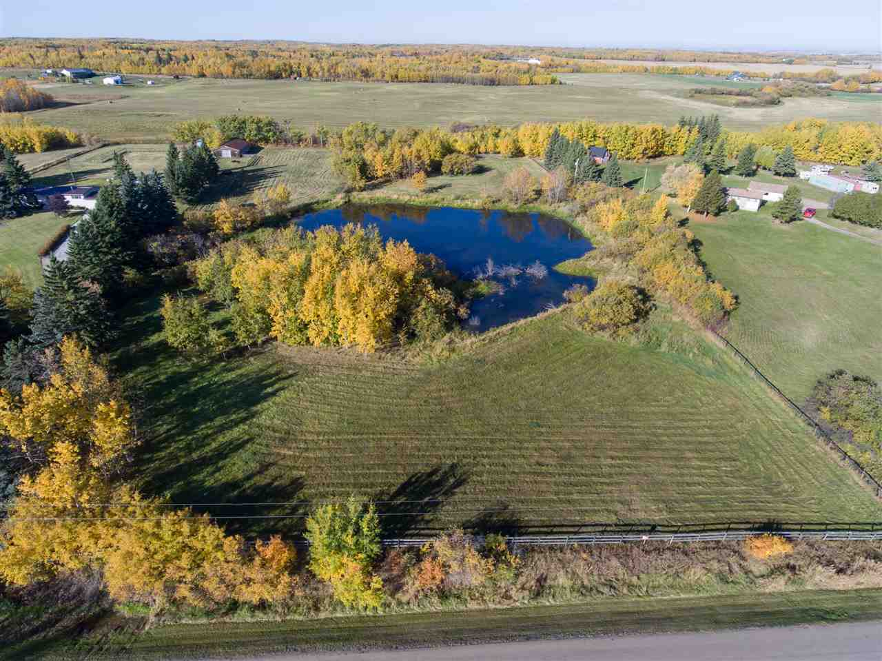 3.64 ACRES UNDEVELOPED....POSSIBLE LOCATION FOR WALKOUT BASEMENT HOME... UTILITIES AT PROPERTY LINE. This gorgeous parcel of land provides fencing on 3 sides of the property, originally set up for horses, therefore no barb wire. A must see!