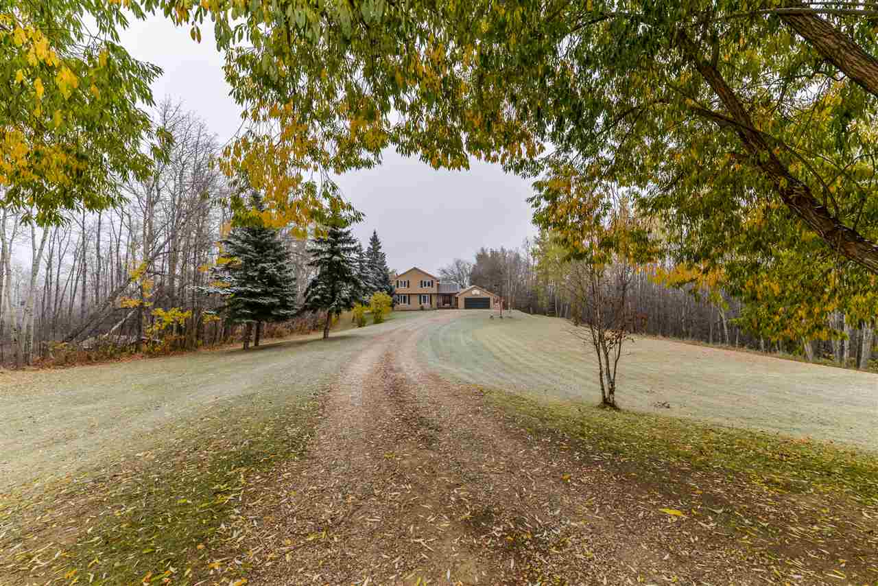 Private... serene... peaceful. Welcome to your new home at Bridgewater Properties. Perfectly situated at the back of a cul-de-sac, this 2.6 acre property is an acreage-lover?s dream. Boasting hardwood flooring and main-floor laundry, this home also features a wonderful kitchen with black appliances & center island, formal dining room, large living room, 5 total bedrooms (including a king-sized master with soaring vaulted ceilings, 4-pc bath, and private balcony access), fully-finished basement, and newer windows (2012) and shingles (2016).  As for the property itself - let?s be honest - the VIEW alone will leave you breathless.  With opportunities to check out the lake from multiple vantage points & walking paths, you?re sure to find what you?re looking for here ? outdoor fire-pit, mature trees & shrubs, storage sheds, RV parking, heated double-attached garage, ample space to build a future shop, exterior decks to entertain your guests, and so much more!