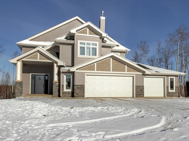 """""""ONE OF A KIND""""! STUNNING CUSTOM BUILT HOME! AMAZING WALK-OUT TREED LOT! GREAT LOCATION!  WELCOME TO LOT 102 IN PARKLAND COUNTY'S PRESTIGIOUS """"BRIDGEWATER PROPERTIES""""! THIS INCREDIBLE 2016 BUILT WALK-OUT BI-LEVEL IS BREATHTAKING! FEATURES INCLUDE 3300 SQUARE FEET OF HIGH-END AND MODERN LIVING SPACE...5 TOTAL BEDROOMS...A MASSIVE TRIPLE 41X24 ATTATCHED HEATED GARAGE WITH SEPARATE BATHROOM...CUSTOM IVORY KITCHEN WITH MARBLE BACKSPLASH, ENGINEERED ACACIA FLOORS, GAS RANGE, STAINLESS APPLIANCES, AND A QUARTZ WATERED ISLAND..LIVING ROOM HAS A CUSTOM WAINSCOTING FIREPLACE AND BUILT IN SHELVING..OPEN STAIRWELL LEADS TO MASSIVE UPPER LEVEL MASTER BEDROOM WITH VAULTED CATHEDRAL CEILINGS, GAS FIREPLACE, HARDWOOD FLOORS, AND A """"JAW-DROPPING"""" WALK-IN CLOSET...ROYAL ENSUITE IS 5 PIECE FEATURING HIS/HER SINKS,GLASS SHOWER AND OVER-SIZED SOAKER TUB...THE WALK-OUT BASEMENT IS FINISHED WITH 10 FOOT CEILINGS, QUARTZ WET BAR, 2 ADDITIONAL BEDROOMS, EXPOSED AGGREGATE WALK-OUT PATIO, AND BOILER INFLOOR HEATING..WELCOME HOME!"""