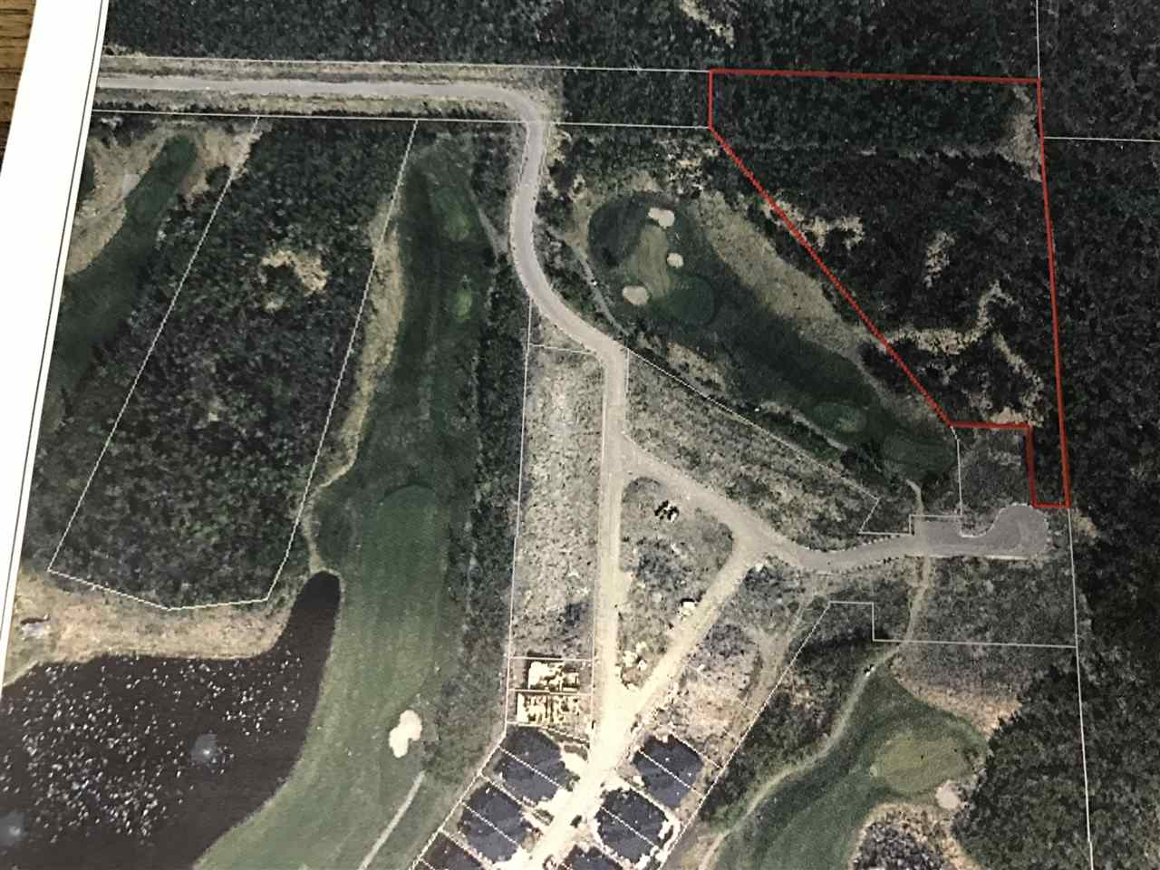 This is a 5.09 acre lot. Treed. Backing Northern Bear Golf Course. Northern Bear has recently been purchased by a new owner and had opened up for a great 2017 season!  The property is at the North East corner of a development that being built as walk out bungalows. It appears to be zoned for the same use and is on the same road and in proximity to the same water and sewer services. However, this is a foreclosure listing and there will be no warranties as to: usage, services, road access, whether is sub dividable, etc. This research will be entirely up to the buyer. Schedule A must accompany offer. All deposits to be certified / bank draft. Happy researching!