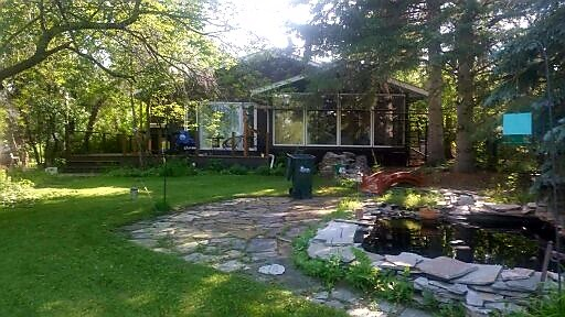 Great lake front property in South Cooking Lake.  1800+ square foot bungalow greets you with large entrance, vaulted ceilings and open kitchen/living room.  Recent renovations in kitchen with plenty of cupboard and counter space.  3 generous sized bedrooms including massive master bedroom.  Peaceful/relaxing yard overlooking lake off the back deck.  Double over sized detached garage completes this lake front home.