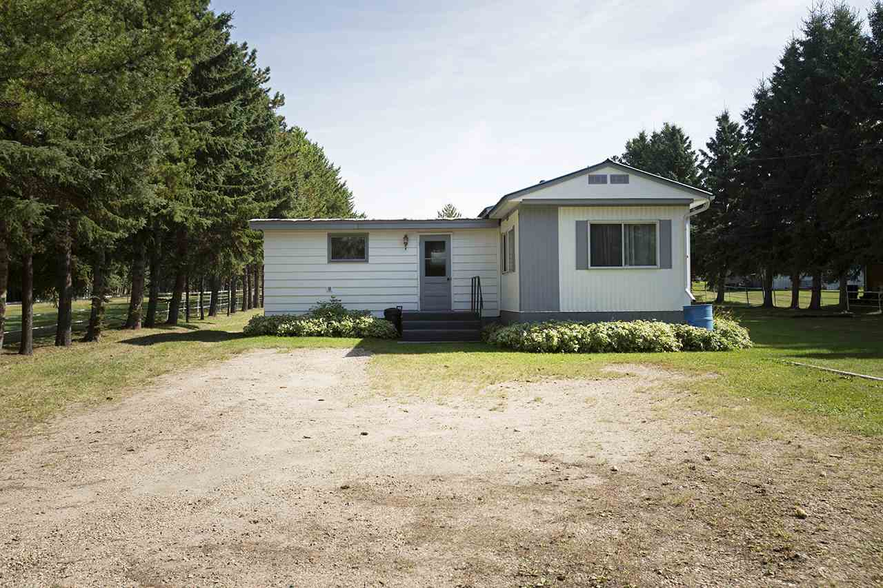 Welcome to this country cozy single wide mobile home placed on a landscaped 1.5 acres. Ideal for first time home buyers, investors or anyone looking for a quick drive to Pigeon Lake. It has been freshly painted, inside and out and is awaiting your personal touch to make it your own.  A brand new furnace was just installed Feb 2018. Most of the windows have been replaced, an addition to create an entry way and to make room for a bedroom has been added. There are fruit bearing trees throughout the property including saskatoons, apple and cherry trees. The property is fully fenced and cross fenced toward the back making it an ideal place to store your quad or sled. With a little work, this home could be your get away destination.  There is a single car garage that was being used as a shop. If you're a welder, it's already set up for the trade! It?s 20 minutes from Pigeon Lake Provincial park, walking distance into town and to schools, creating a country feel that?s close to town. It?s a must see!