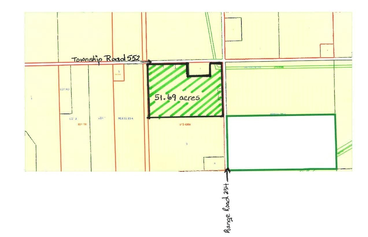 Great opportunity with over 50 acres of land on a corner and siding onto the train track. Great future development opportunity!