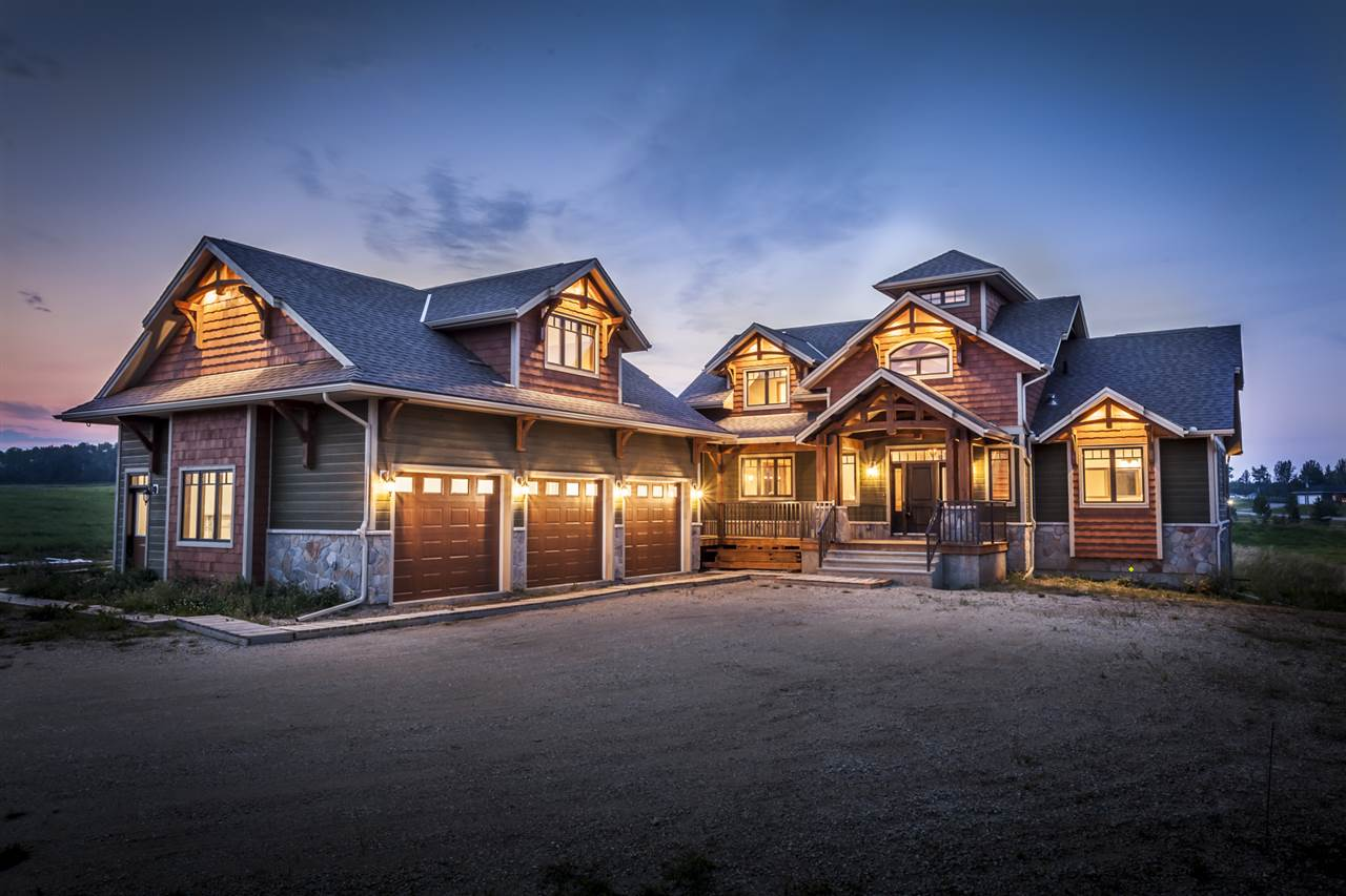 This Stunning home won 2nd in Canada for Design! Enter the grand foyer with natural timber frame accents, custom staircases up & down, towering 18 ft. ceilings in the Great Room & custom designed natural stone fireplace and timber Frame accents through out. A huge gourmet kitchen with custom built cabinets, built-in S/S appliances, a walk-in pantry & lots of granite counter space will impress any chef. Conveniently located on the main is the Master bedroom with vaulted ceiling &-piece ensuite. The upper level features 2 bedroom & spacious loft overlooking great room. A  630 sq.ft. bonus room over the garage awaits an office, playroom or nanny suite. Full walk-out basement with 2 additional bedrooms 4-piece bathroom, games & family room with access to covered patio. Extra features include air conditioning, screened in porch, 2070 sq.ft. cedar wrap around decking, 3 bay garage with elevated ceiling for car lift. The Estates is the nearest Premier County Subdivision where you can enjoy country living.
