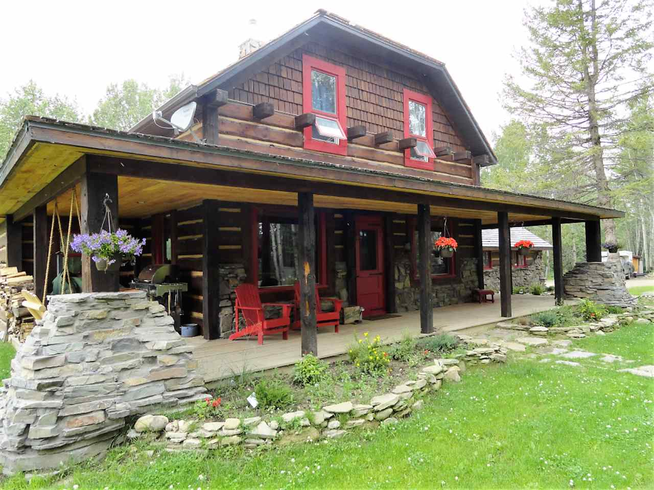 Rustic Charm! You won't find another property like this! 3 bedroom, office and 1 bathroom. Fully landscaped half acre, garden & firepit. Completely rebuilt with beautiful oak cupboards, concrete counter tops, slate bathroom details, refinished hardwood floors and stunning stone fireplace. This one of a kind property backs onto protected land and is only a short walk to lake access with shared dock.