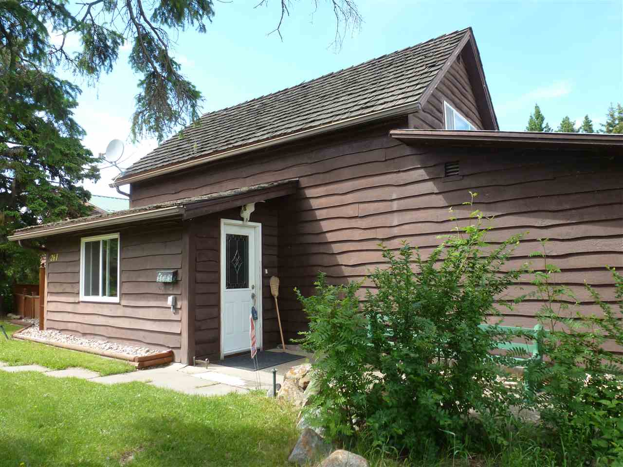 *ESTATE SALE* $299,900 - Must Sell this charming Character Semi-Bungalow House built in 1912 overlooking NorthEast shores of South Cooking Lake was built. Huge 2-Storey Garage w/Artist's Studio on upper level, was added some time later. A total of 1502 Sq Ft of Living Space on the Main and Upper levels, plus partial Basement which houses the Utility Room and Storage area. The main floor features a spacious and open Living Room with a majestic Natural Gas Fireplace and Dining area overlooking the Lake, all with Hardwood flooring throughout. In addition, there is a Galley Kitchen, Laundry Room, Master Bedroom and 4-piece Bathroom. The Upper floor is currently one big Bedroom with room for 5 or 6 beds. The Double Detached Garage is 28' x 28' and is 2 storeys high with the Studio upstairs having its own furnace. The property itself is high on a hill and provides a glorious view of the Lake. It has its own Drilled Well and comes with Water Treatment Equipment. This Charmer must be seen to be fully appreciated.