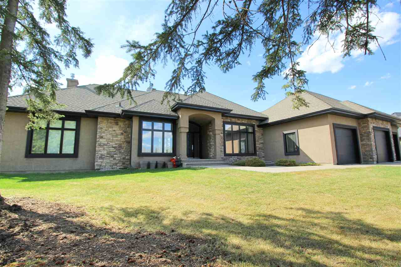 This UPSCALE BUNGALOW on 1.06 ACRES in PRESTIGIOUS ATIM CREEK SPRINGS is just minutes from SPRUCE GROVE and LOADED with UPGRADES. Nestled in a cul de sac on a treed, private lot that's fully fenced and has a paved driveway up to the TRIPLE, HEATED GARAGE. This CUSTOM FOX MAPLE built home features over 4,200sq.ft of living space and offers LOADS OF WINDOWS, MODERN DECOR, INFLOOR HEAT IN BASEMENT, AIR CONDITIONING, 3 FIREPLACES, 3 SEASON SUNROOM, CHEF'S DREAM KITCHEN with GRANITE COUNTER TOPS, MAIN FLOOR LAUNDRY, DEN/FORMAL DINING ROOM, HUGE MASTER with CALIFORNIA CLOSET ORGANIZERS in the WALK-IN CLOSET, LUXURIOUS 5 PIECE ENSUITE with DOUBLE SIDED FIREPLACE and so much more! The basement is FULLY FINISHED with large family room, bar, 2 additional bedrooms, recreation area and LOADS OF STORAGE ROOM with access to the garage! The yard has beautiful retaining wall with huge concrete pad for the hot tub, pool, trampoline, or whatever you desire! Enjoy COUNTRY LIVING at IT'S FINEST, NOTHING TO DO BUT MOVE IN!!!
