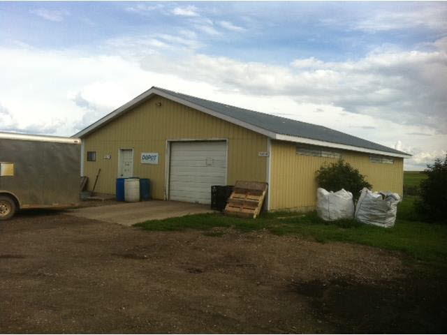 20 ACRES WITH POWER AND A LARGE SHOP!!! What a great location to build your home. There is an old well (no warranties), two smaller dug outs, a single car garage, older pole shed, some older sheds and a 50x30 shop with lean-to.  Only 5 mins East of Holden. City water is a possibility as it is at the neighbors.