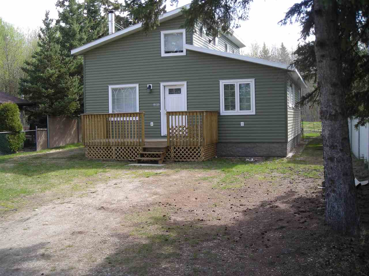 Charming home in Mulhurst Bay, north side of Pigeon Lake. This home offers 2 bedrooms plus upper loft area, 1 bathroom with Jacuzzi tub, all appliances will stay, wood stove in living room, vaulted ceilings & a short walk to the lake.