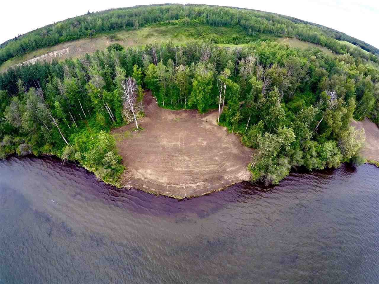 ONCE IN A LIFETIME OPPORTUNITY to own PRIVATE WATERFRONT land on Lake Wabamun next to Seba Beach! This RARE find consists of 5.39 acres and boasts over 1,400 ft of waterfront, a variation of sloped areas and flat areas, winding trails along the lake for the outdoor enthusiast, sandy beach with Riparian Rights to the water breathtaking Southwest waterfront exposure to enjoy the sunsets, and a plethora of trees for privacy. Located a short 45-mintues drive West of Edmonton, this property is a spectacular building site!