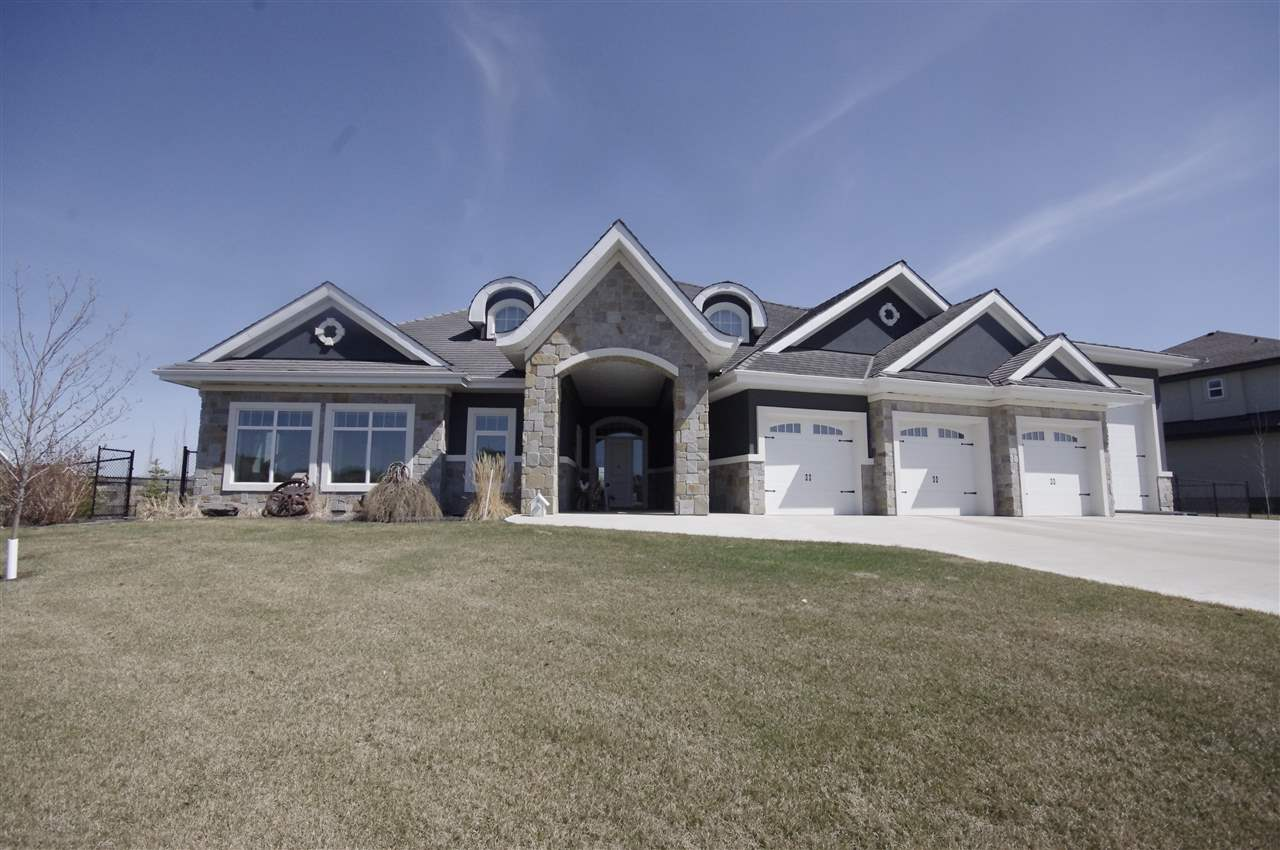 This custom built home is stunning! Located on .53 acre & on city water & sewer. Amazing  attached 5 car garage PLUS 46 ft RV bay with 14 ft door makes this a fabulous structure! More yet, a 960 sq ft attached workshop is a separate space & can be used for woodworking or other hobbies.  Stunning chef's kitchen provides you with amazing cabinets, quartz & granite counters, extra large island, sub zero fridge, gas range & a pantry like you've never seen. The huge dining area has a patio door that leads to the gorgeous backyard. A wall of windows across the back of the house lets in loads of natural light. Three good size bedrooms, each with their own ensuite bathroom. The living room has a feature wall of a beautiful wood burning fireplace & doors to the covered patio. The hobby room has lots of cabinets & counter space & the exercise room has plenty of room for all your gym equipment and is complete with a wall of mirrors. A beautiful home for living, hobbies & interests!