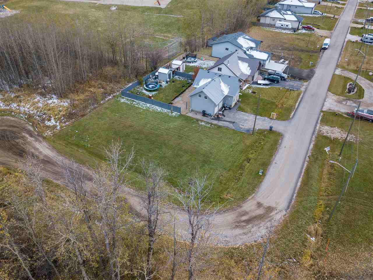 Enjoy this large corner lot in the newer community of Grasmere Glens in Alberta Beach. 5 minute walk to the school, lake, or golf course! The municipal sewer and Natural gas, power, telephone and cable at the roadway. A short drive from Stony Plain or 40 minutes west of Edmonton and you will be at your lake home! Conveniently located at the school and golf course this end lot is surrounded by trees.