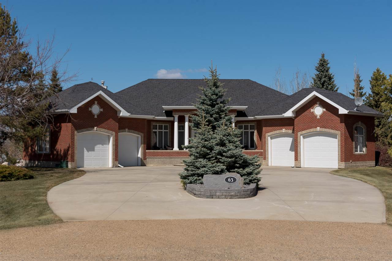 Stunning Lakeshore Estate custom built by Alliance Homes. This gorgeous 2,208 sq.ft. walk-out bungalow backing onto Big Lake on 0.51 acres.This spacious main flr. welcomes you to a bright Great rm w/floor-to-ceiling windows, vaulted ceilings, gas f/p & opens to a gourmet kitchen w/built-in S/S appliances, custom cabinetry, centre island & breakfast nook w/access to partially covered deck. Also located on the main flr. are the Mstr. bdrm w/5-piece spa like ensuite, lg. bay window w/a stunning view overlooking the lake & priv. access to the partially covered deck, formal Dining rm, an add?l bedroom & Laundry rm w/access to the 4-car garage. The lower walk-out lvl offers 2 add?l lg. bdrms, 1 w/an ensuite & another full bath, lg. family rm, recreation area, exercise area, in-floor heating w/access to the covered patio & priv. yard. This property has the convince of being minutes from city limits w/city water & sewer. Few homes offer such stunning sunrise/set views over this beautiful, clear & clean lake.