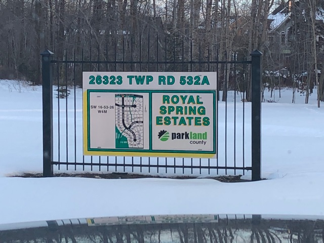 LAST lot available in this exclusive lush neighborhood.  1 acre executive lot near big lake and Edmonton Springs golf course.  Land cleared for walk out basement.  READY to build.  Fully serviced to the lot line - water, sewer and gas.