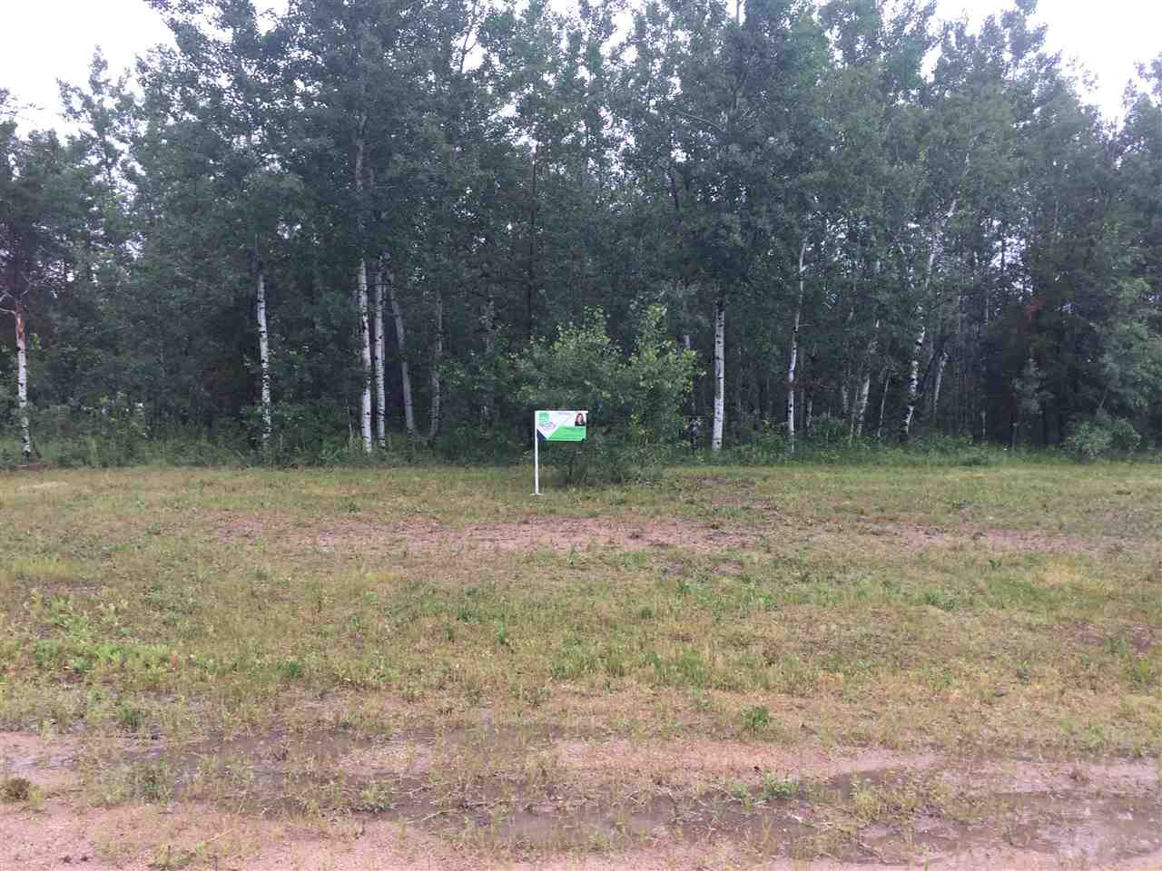 This lot is Nicely nestled in quiet subdivision .The roads are paved to lot and street lamps light the way to your 1.5 acre Lot. THIS  SUBDIVISION IS ONLY 10 MINUTES FROM COLD LAKE .