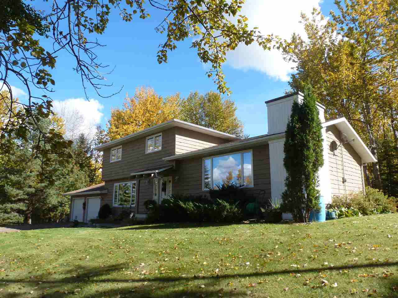 2-Storey w/Basement(1978) - Shows 10+!  A very nice 2000+ Sq Ft renovated Country Home on 3.12 landscaped treed acres situated a mere 10 minutes East of Sherwood Park. Features include a total of 4 Bedrooms, including Master w/Ensuite, Walk-In Closet & Balcony, 2.5 Bathrooms, Kitchen w/Dinette, Formal Dining Room, spacious Living Room w/NG Corner Fireplace, plus Family/Rec Room. And a Double Attached Garage and Deck/Patio overlooking a creek and landscaped back yard! Quick Possession Available!