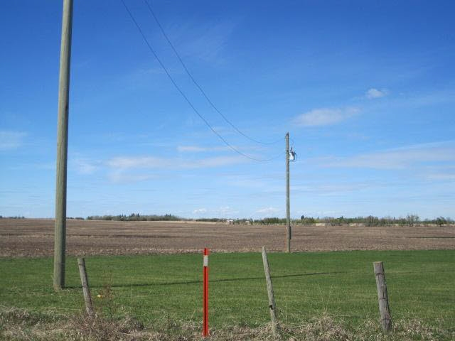Are you ready to build and in need of land in close proximity to Westlock? Look no further! Beautiful flat 2.99 ACRES just five miles South of Westlock. Property has POWER and is READY FOR YOUR FUTURE HOME (BUILD/MOBILE/MODULAR). A must see. Property is subdivided, surveyed and has a shared approach. Town water line runs alongside east side of road, can be hooked into for a fee. Close to Town, ACCESS TO TOWN WATER! Buy today, and build tomorrow.