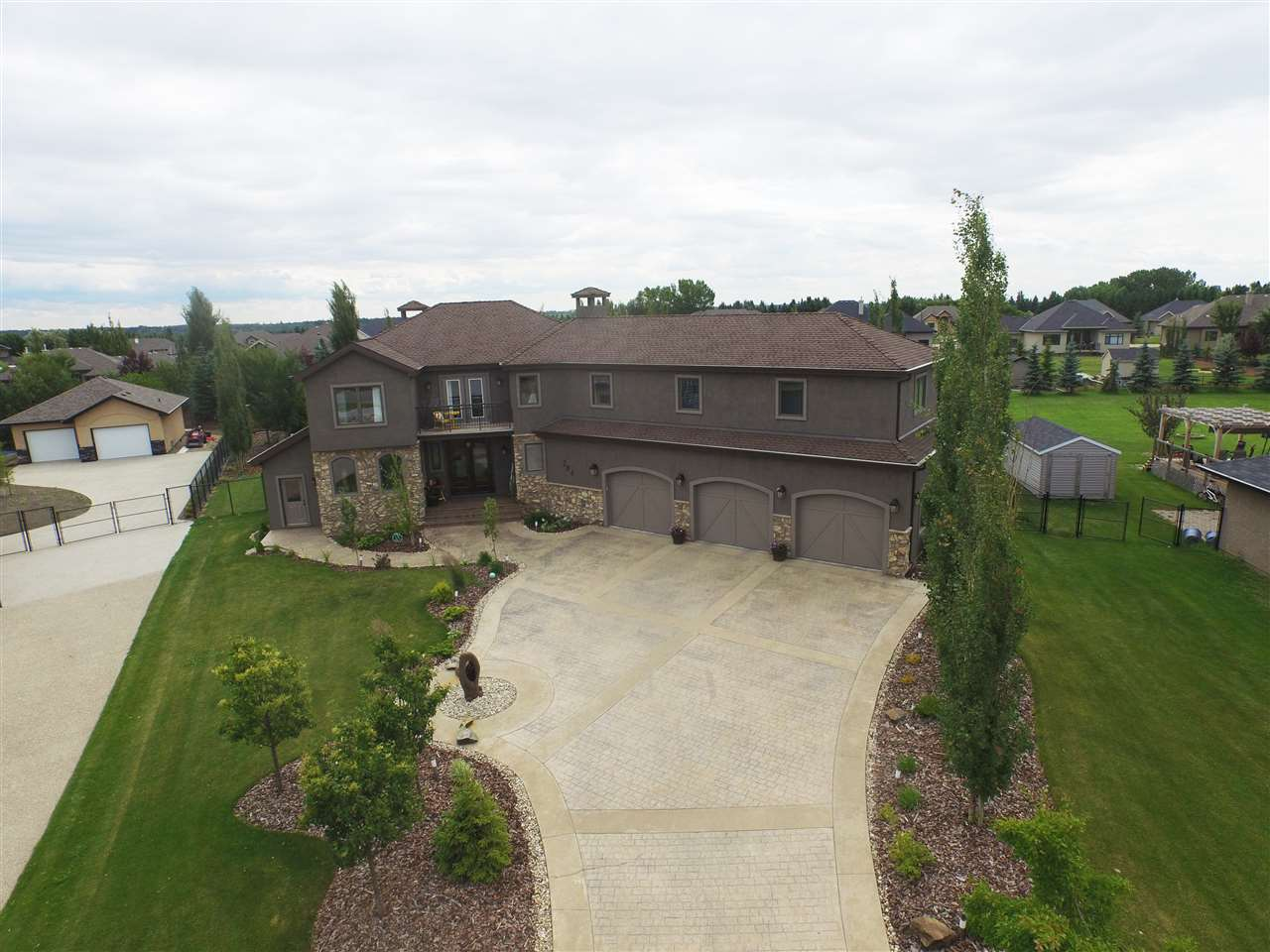 Stunning 2 storey Estate home in The Banks of Sturgeon Valley. W/ over 6000 sqft of living space, this 5 bed, 5 bath home is perfect for any growing family. Remodelled throughout w/ clean crisp finishings, yet elegant & functional design. Stucco & stone exterior w/ gorgeous landscaping will catch any onlookers eye. Main floor is one of beauty w/ heated travertine flooring, chefs dream kitchen w/ gourmet appliances, butlers pantry, fresh white cabinets, quartz countertops & large island. Massive dining area overlooking the private, fully fenced & landscaped yard. Stunning living room w/ plenty of natural sunlight & stylish 2 sided fireplace & main floor den complete this well designed home. Upper level includes 4 bedrooms, laundry room & bonus area. The master retreat is sure to impress w/ stunning 5 pc. ensuite w/ soaker tub. Lower level includes the 5th bedroom, full bath, media room w/ wet bar & separate wine room. Quality of finishings in this home are above the rest. A must see to appreciate!!!