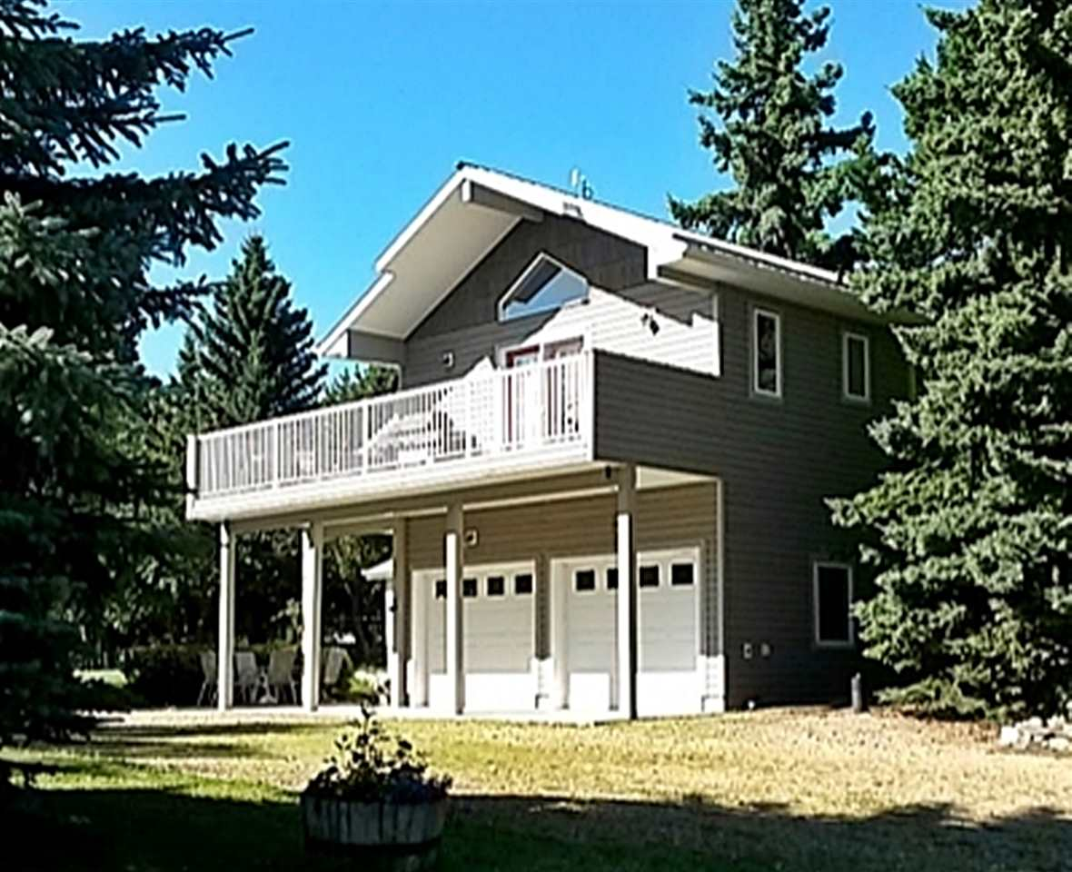 Visit REALTOR® website for additional information. Your perfect get away! This 2 story cottage on Pigeon Lake! Lots of bright windows, vaulted ceiling, kitchen, master bed,  living room, bed & bath upstairs. Ground floor is a dual purpose double garage that offers extra living space when family comes over! Beautiful lot with a lake view!