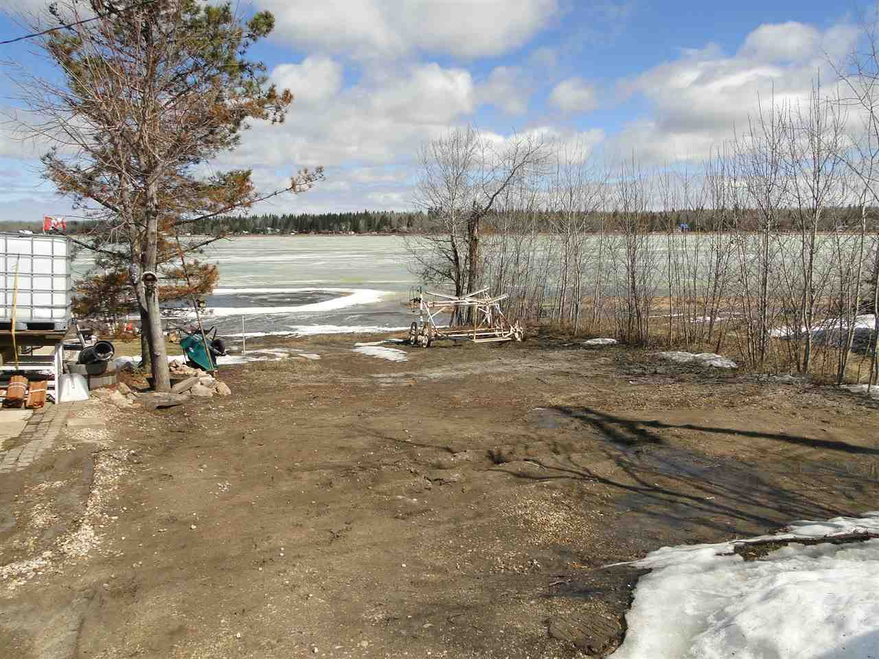 Located in the Summer Village of Sandy Beach this .15 acre waterfront property with beautiful views of the lake and wildlife is ready for a new home or cabin. A great spot for year round living, or a place to play and/or sit back and unwind. There is an existing septic holding tank that will need to be determined if still usable.