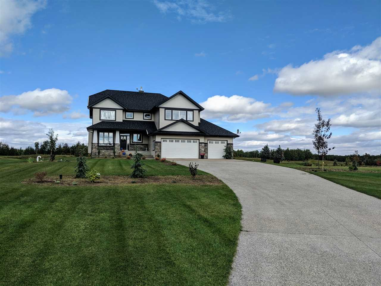Minutes to Edmonton, this Kimberley custom home is located on a full acre backing Blackhawk golf course. With 3100 sqft, this is truly a custom and unique build. From the beautiful hardwood on the main floor and light from every direction, it makes this large home feel even bigger. The living room boasts double sided fireplace the full height of the 20 foot vaulted ceilings, huge separate dining area and a kitchen to die for. This gourmet kitchen features granite counters, custom hood fan, all GE Monogram appliances featuring a 48? gas stove and walkthrough pantry. Upstairs you will find 3 generous bedrooms and bonus room. The master retreat has private balcony overlooking the golf course, gas fireplace, and ensuite with large soaker tub, tiled shower with multiple shower heads and his and hers sinks. Throughout the house is a $15,000 audio system that works off your phone. With a Walkout basement and huge triple garage, what more could you want?