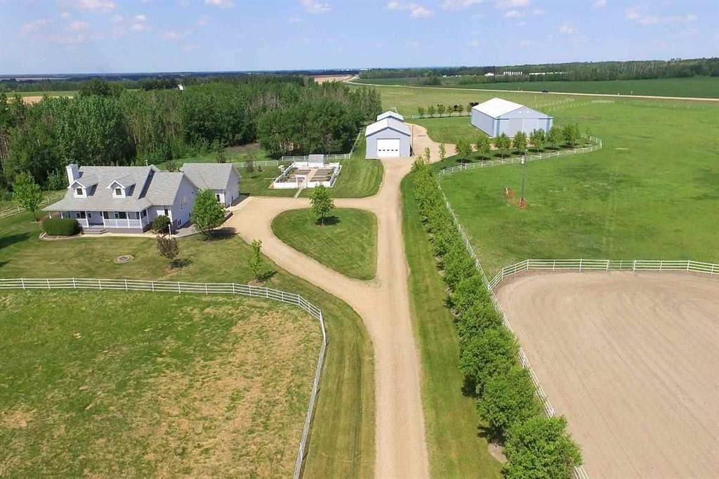 Location, Location, Location Then add one of the most beautifully landscaped hobby farm and I'm confident you have found your new home.  This 41+ acre beauty with 30-35 cultivatable acres is located 1/4 mile west of Hwy 44.  There's a gorgeous 2077 sq. ft bungalow including loft with a fully developed raised basement. (large windows).  There are 1+2 bedrooms (could be 5 bedrooms) 3 full en suites, tons of upgrades & 26 x 25 attached heated garage.  For the hobbyist or someone wanting to run a business this property has a 38 x 60 heated shop with 14 ft. doors, a 60 x 120 machine shed and a 32 x 50  horse barn.  Just under 60K spent on white perimeter and interior fencing.  There's an outdoor riding arena, large dugout, driveway is gravel crushed asphalt, 3 water hydrants, 2 heated waterers and so much more. Show and sell with confidence.